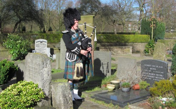 Bagpipe player at funeral