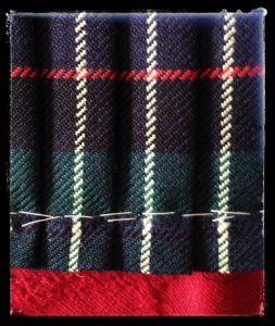 The pleats had been held in transportation by two rows of basting stitches.