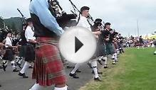 Massed Bagpipe bands march