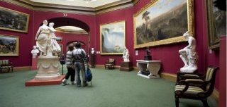 Visitor look upon photographs in nationwide Gallery of Scotland,  Edinburgh